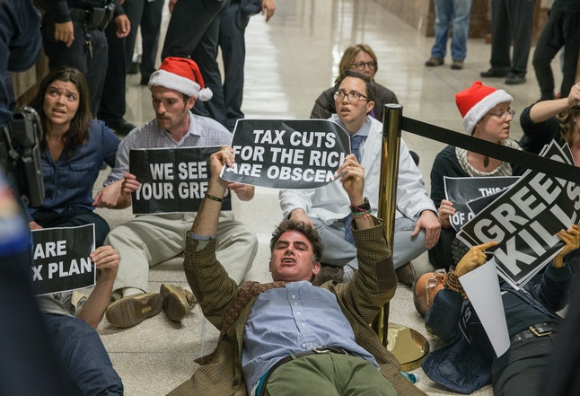 Protesters demonstrate near the full Senate budget committee markup of the tax reform legislation on Capital Hill on Nov. 28.