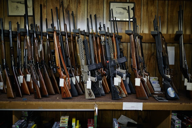 Row of rifles on display at Trail Creek Trade Co., St. Ann, Missouri.