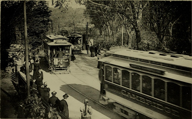 Boston's green line trams carry people to the city's Public Garden in 1898.