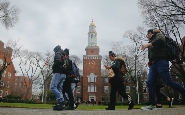 Brooklyn College students walk between classes on campus.