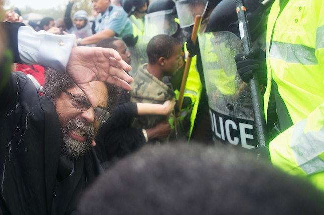 FERGUSON, MO - OCTOBER 13: Author and activist Cornel West protests outside the Ferguson police station on October 13, 2014 in Ferguson, Missouri.