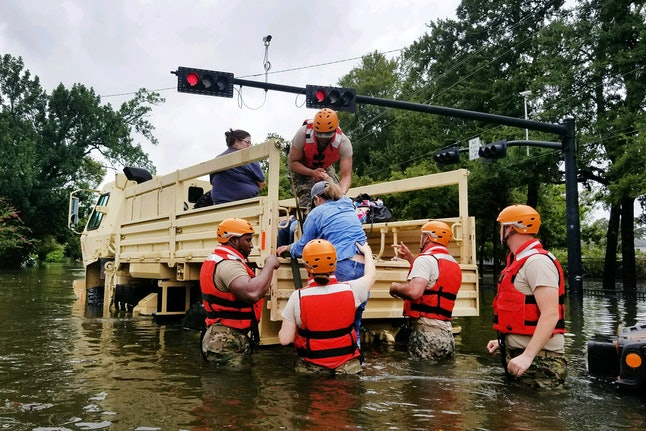 Texas National Guardsmen help rescue residents affected by flooding caused by Hurricane Harvey in Houston