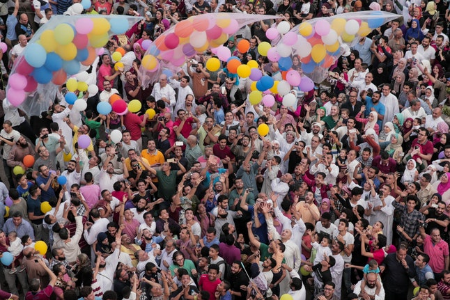 Egyptian Muslims release balloons at the end of prayers on the first day of Eid al-Fitr.