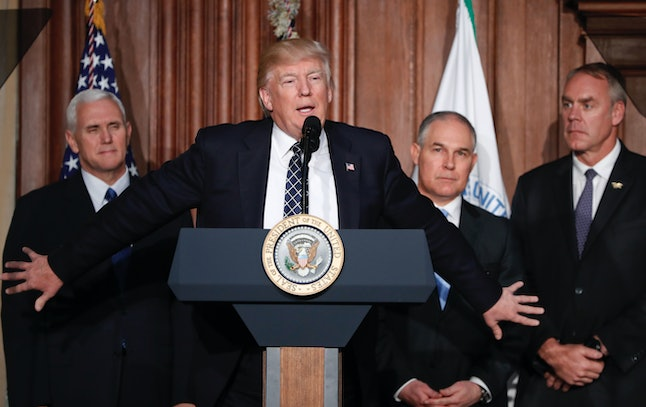 President Donald Trump announces an executive order gutting the Clean Power Plan with Vice President Mike Pence and EPA head Scott Pruitt.