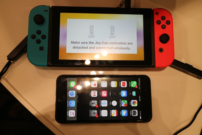 Nintendo Switch with Joy-Con attached vs. iPhone 7 Plus