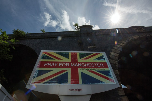 A giant TV screen displays Pray for Manchester after a terror attack on Monday, May 22, 2017.