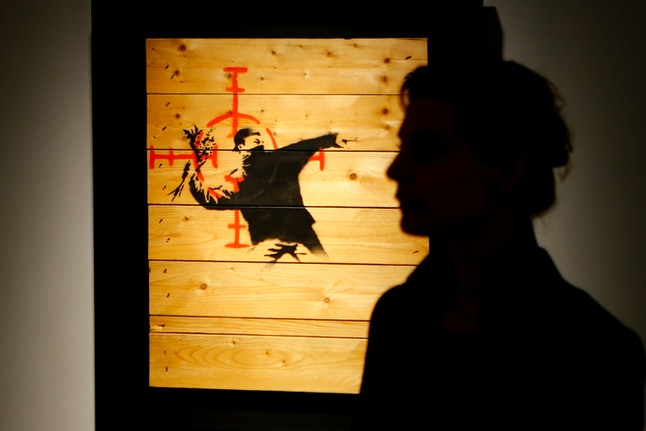 A work by British artist Banksy is shown in his first retrospective exhibition in Germany.