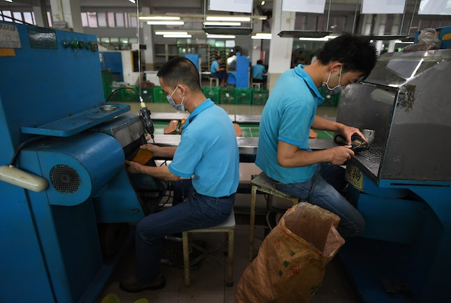 Factory workers at an Huajian Group factory that manufactures Ivanka Trump-branded shoes.