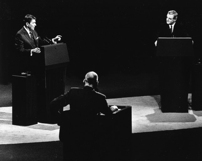 U.S. President Ronald Reagan, left, and his Democratic challenger Walter Mondale, right, are seen during their televised presidential debate, in Kansas City, Missouri, Oct. 22, 1984.