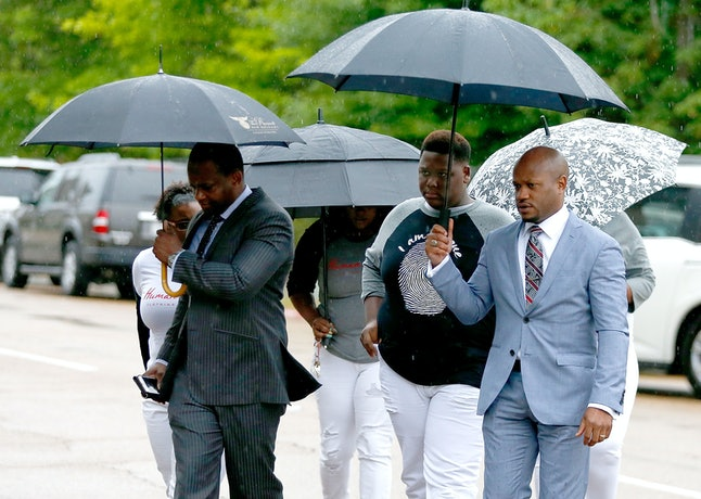 Alton Sterling's son Cameron Sterling walks to up to the U.S. Federal Courthouse on May 3 in Baton Rouge, Louisiana.