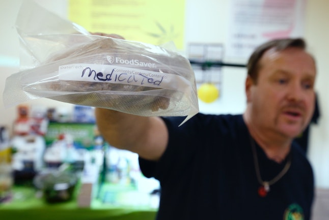A man holds a bag of medical marijuana-infused cookies in 2014 in Massachusetts.