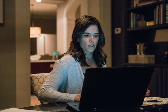 LeAnn Harvey, played by Neve Campbell, looking over hacked classified data