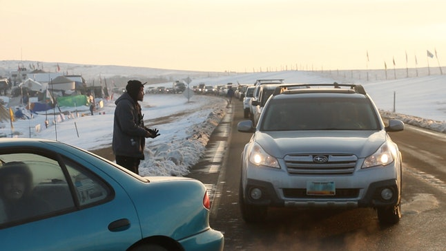 Cars lines up at sundown, bringing in hundreds of veterans.
