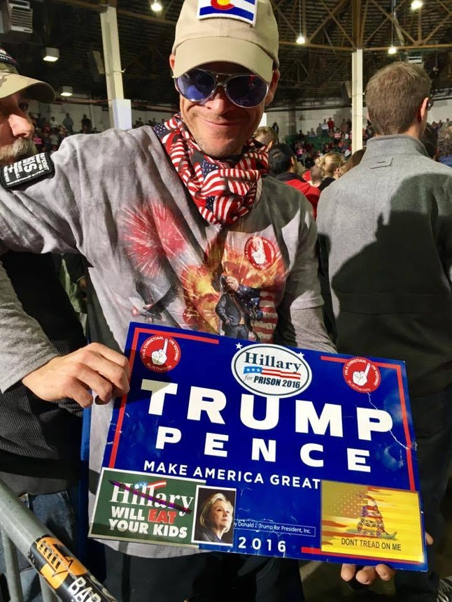 A Donald Trump fan displays his enhanced rally sign in Denver.