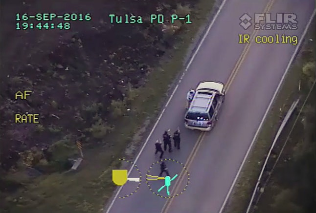 A screen capture of police video shows the moment Tulsa officer advanced on Terence Crutcher, who is seen near the driver's side door of the SUV.
