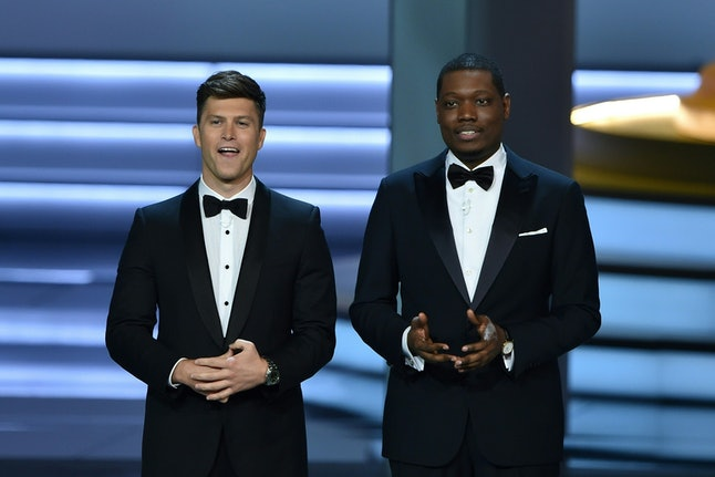 Hosts Colin Jost and Michael Che speak onstage during the 70th Emmy Awards at the Microsoft Theatre in Los Angeles, California on Sept. 17.