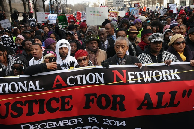 Rev. Al Sharpton and the families of police violence victims march in Washington, D.C., in December 2014.