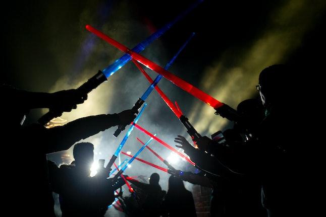 'Star Wars' fans raise lightsabers.