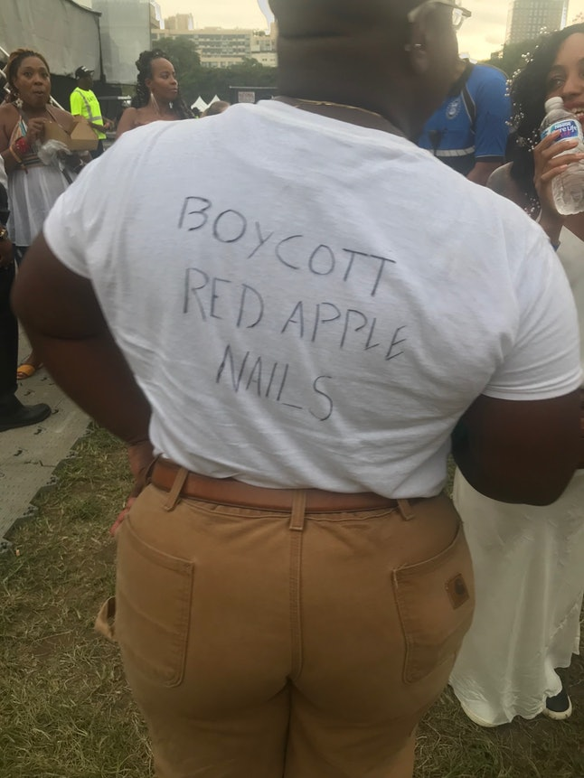 """The back of Donnley's shirt read """"Boycott Red Apple Nails,"""" a response to an incident at the nail salon in Brooklyn, where a black woman was assaulted by nail salon employees."""