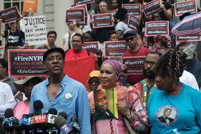 Gwen Carr, right, whose son Eric Garner who was killed by an NYPD officer, is joined by Hawa Bah, center, mother of Mohamed Bah, and Eric Vassell, father of Saheed Vassell, during a news conference outside New York City Hall on in July.