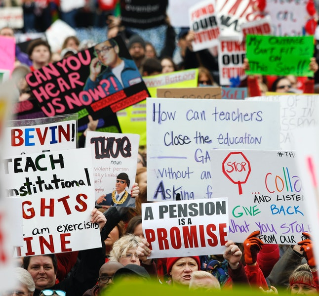 Public school teachers and their supporters protest against a pension reform bill at the Kentucky State Capitol on Monday.