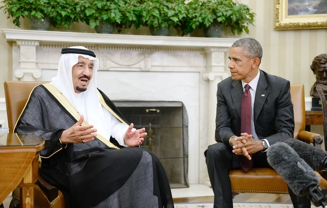 WASHINGTON, DC - SEPTEMBER 04:  U.S. President Barack Obama looks on as King Salman bin Abd alAziz of Saudi Arabia speaks during a  bilateral meeting in the Oval Office of the White House September 4, 2015 in Washington, D.C. The President and the King were expected to discuss various issues including joint security and counter-terrorism efforts