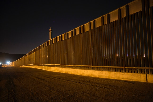 A steel border fence stretches along the United States' southern border in New Mexico.