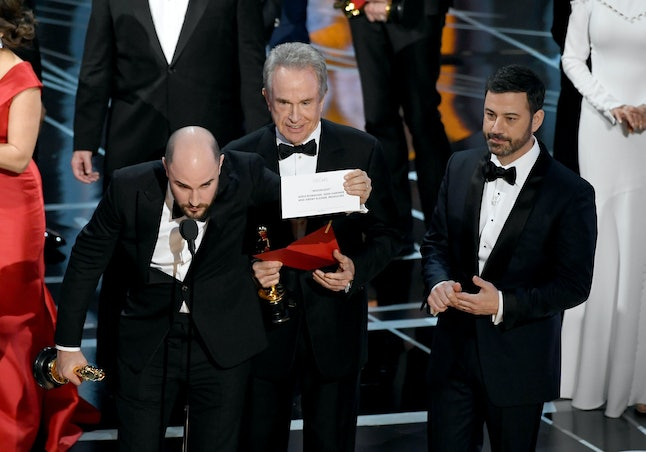 'La La Land' producer Jordan Horowitz holds up the winner card reading actual Best Picture winner 'Moonlight' with actor Warren Beatty and host Jimmy Kimmel.
