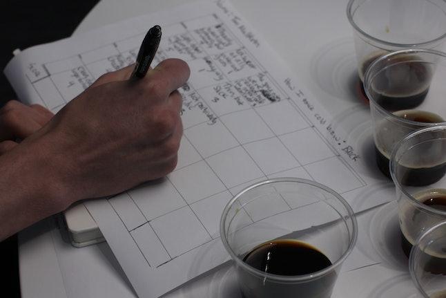 One staffer fills out a scorecard.
