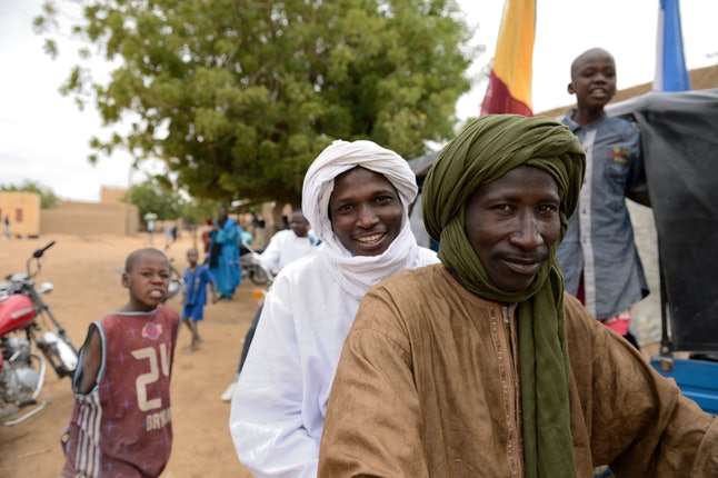 Touareg people celebrate in Niafounke as Malian and French soldiers entered the historic city of Timbuktu, occupied for 10 months by Islamists who imposed a harsh form of sharia, on January 28, 2013.