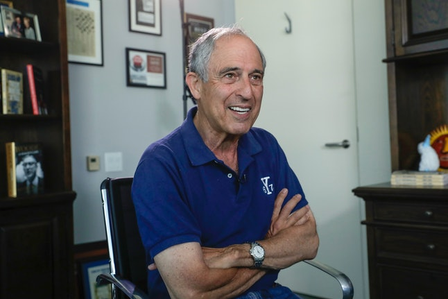 Lanny Davis speaks with the reporters in his Washington, D.C., office in May.