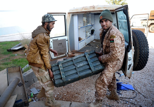 In 2014, Libyan military gather ammunition left by Islamic militia after conflict in Banghazi.