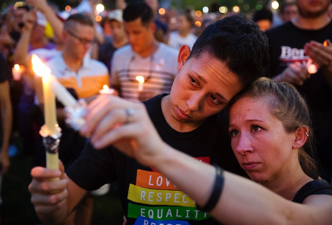 Mourners light candles during a vigil in Orlando, Florida, for the victims of the mass shooting at the Pulse nightclub the day after the 2016 shooting.