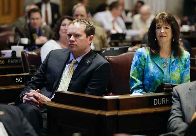 """Rep. Jeremy Durham listens to a debate on his """"exile"""" from House."""