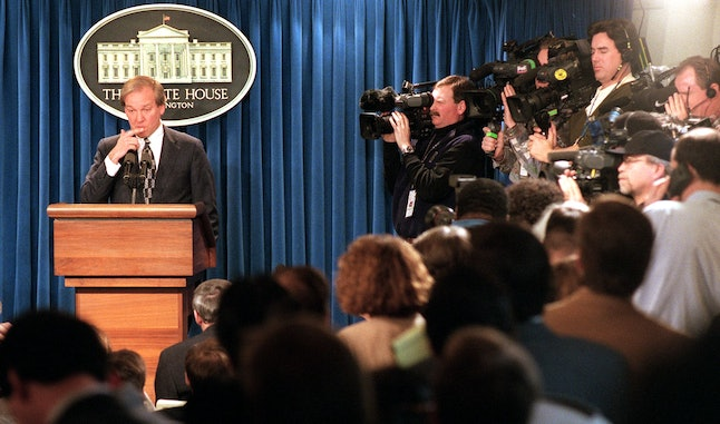 White House Press Secretary Mike McCurry, surrounded by the media, answers questions Jan. 22, 1998 during the daily press briefing at the White House in Washington, D.C.