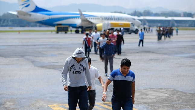 Guatemalans who were deported from the United States arrive at La Aurora International airport in August 2019.
