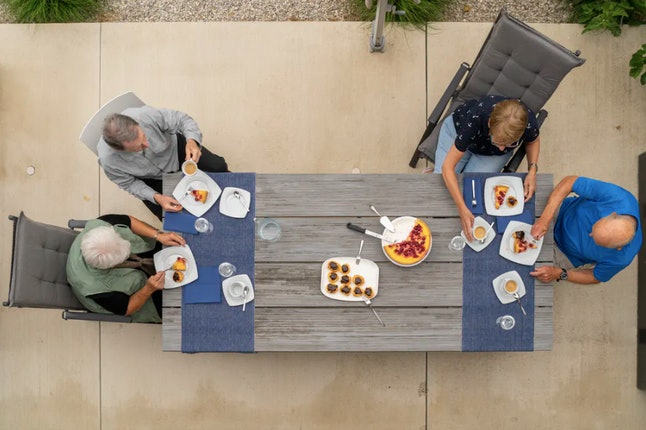 Sitting far apart or even at separate tables outside will reduce the chance of spreading the coronavirus.