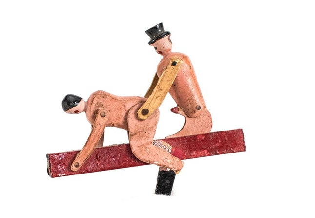 Some figures, like this one carved circa the 1920s, had multiple points of articulation, allowing the user to move handle back and forth to simulate sex.