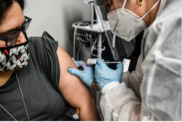 Some lawmakers and economists are suggesting payments as high as $1,000 to $1,500 for a COVID-19 vaccination.
