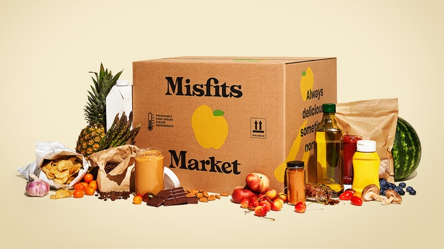 A Misfits Market box, with produce and goods surrounding it.
