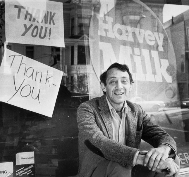 Supervisor Harvey Milk sits outside his camera shop in November 1977.