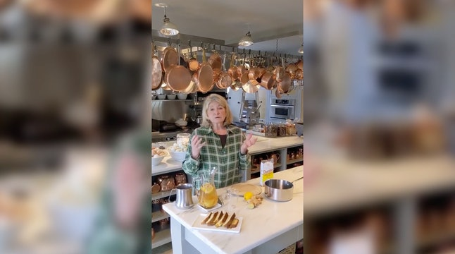 Martha Stewart making a coronavirus cocktail in a kitchen with a ceiling full of hanging copper pots.