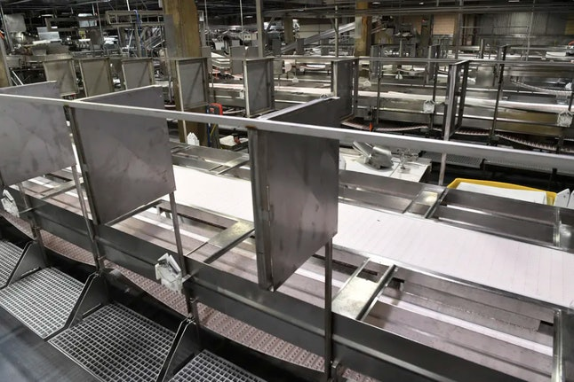 Meat processing stations at the JBS Beef Plant in Greeley, Colo., equipped with new sheet-metal partitions, April 23, 2020. As of early May 2020 the plant had recorded more than 200 confirmed cases of COVID-19 and 6 employee deaths.