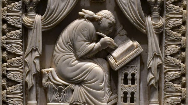 Ivory carving of St. Gregory writing about the life of St. Benedict of Nurcia, 11th century.