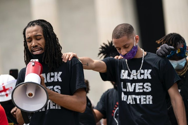 Black Lives Matter protesters pray near the Lincoln Memorial in Washington D.C.