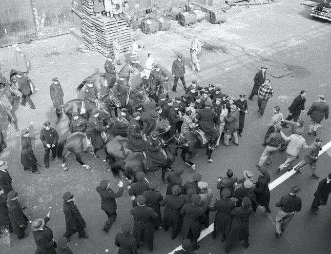 Mounted New York City police officers battle with striking members of the International Longshoremen's Association, March 24, 1954.