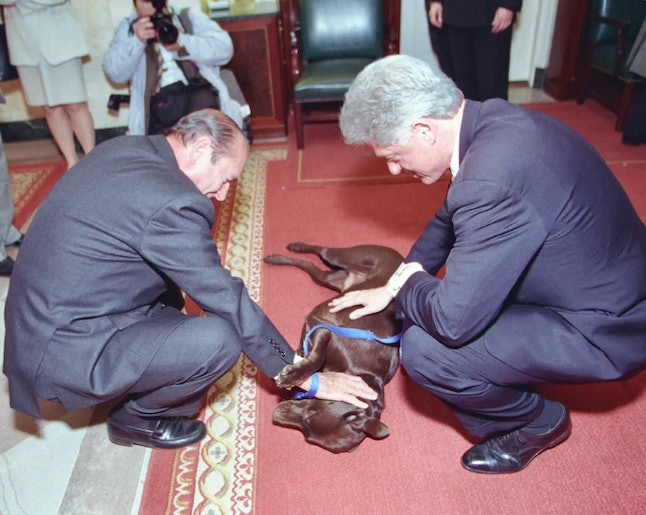President Clinton and President Chirac of France showing Buddy some love in 1999.