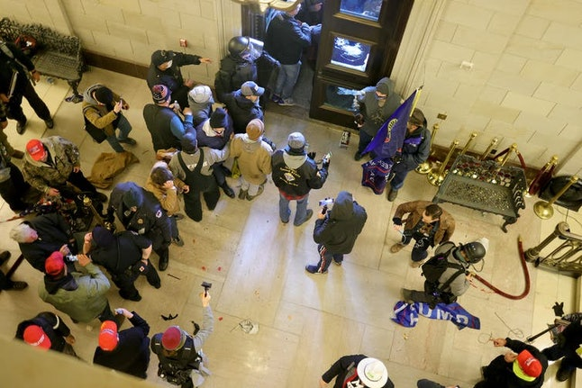Protesters enter the Capitol building.
