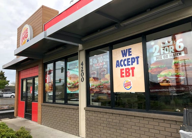 A Burger King in Oakland, Calif. advertising that it accepts benefits issued to low-income families for food.
