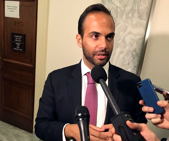 George Papadopoulos, the former Trump campaign adviser who triggered the Russia investigation, talks to reporters after his first appearance before congressional investigators, on Capitol Hill in Washington